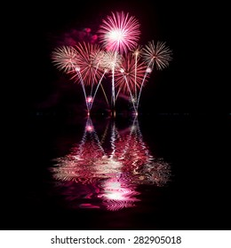Fireworks reflect water  for festival