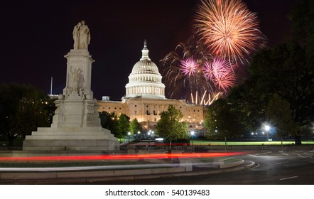 Fireworks rising over Capitol Hill and the peace monument