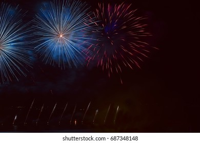 Fireworks salute in the night sky. Colorful sparkling flying lights.