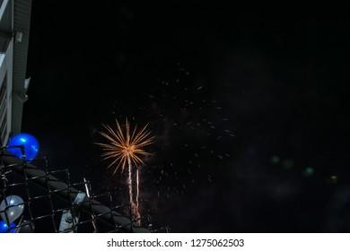 Fireworks seen from football stadium seats celebrating homecoming