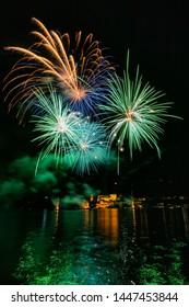 Fireworks show in front of the San Giulio Island, Orta San Guilio, Lake Orta, Novara, Piedmont, Italy