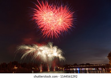 fireworks show on the banks of the Ticino river in the beautiful location of the small village of Sesto Calende on a summer night
