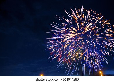 Fireworks in sky twilight. Fireworks display on dark sky background. Independence Day, 4th of July, Fourth of July or New Year.