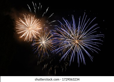 """Fireworks at Traunsee - Every year in Altmünster on Lake Traunsee there is the festival """"The Traunstein shines"""" with large fireworks. - Shutterstock ID 1729063234"""