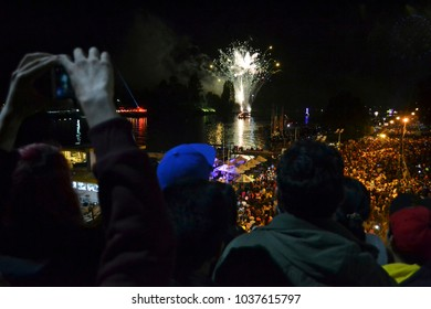 Fireworks  of Valdivian night ( Noche Valdiviana) and  crowd of people  in Valdivia town, Chile, South America