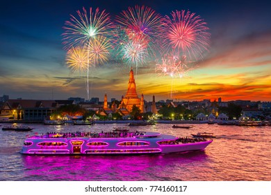 Fireworks at Wat arun and cruise ship in sunset time under new year celebration, Bangkok city ,Thailand