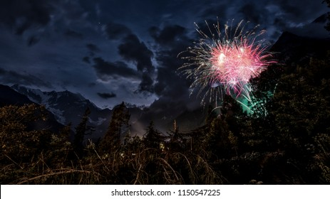 fireworks in the wood with East wall of Monte Rosa and mountains landscape in summer evening, Macugnaga - Piedmont, Italy