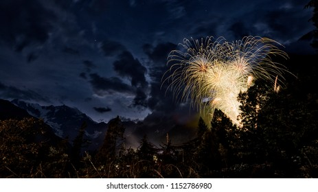 fireworks in the wood with East wall of Monte Rosa and mountains landscape in summer evening