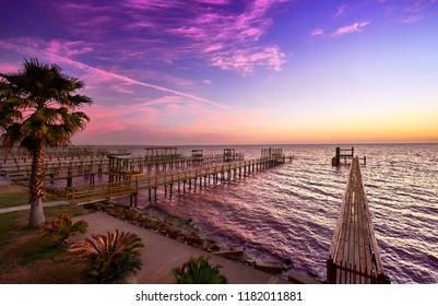 Firey colors in the sky at first light, Galveston Bay, Texas
