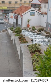 Firgas, Spain. September, 4 th 2018: Water fall in a road of the village.