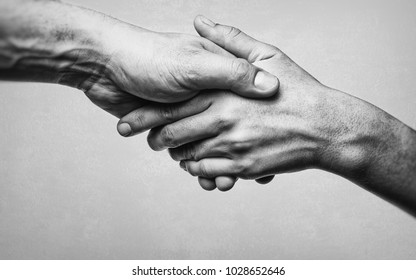 A firm handshake between two partners. Black and white image on white  background.