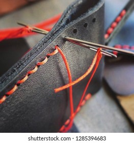 firmware of leather with red threads