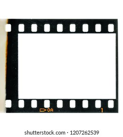 First 35mm film frame or real analogue dia slide on white with signs of usage, first film exposure, retro look