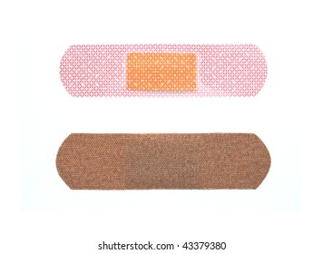 First aid adhesive bandages on white background