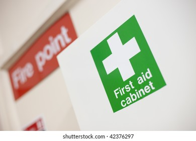 First aid cabinet and fire point label