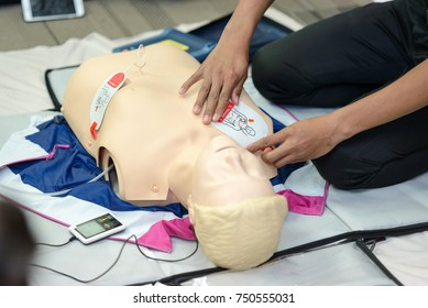 First aid cardiopulmonary resuscitation course using AED training. selective focus placing electrode
