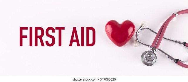 FIRST AID concept with stethoscope and heart shape