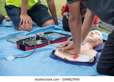 First Aid - CPR Training Chest Compression on Manikin with Automated External Defibrillator (AED) Box in Case of Heart Failure Person - Healthcare Concept