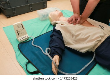 First Aid - CPR Training Chest Compression on Manikin.Healthcare Concept