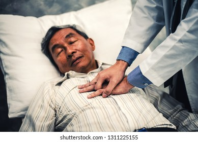 First Aid Emergency CPR on Patient Senior Man who has Heart Attack , Unconscious or Shock , One Part of the Process Cardiopulmonary Resuscitation - Healthcare Concept