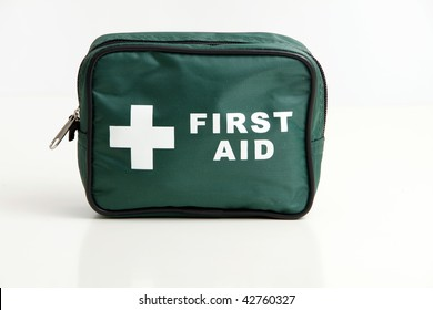 A first aid kit bag isolated on a white with soft reflection