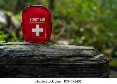 first aid kit bag on stone in nature
