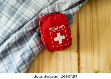 first aid kit bag on wooden background
