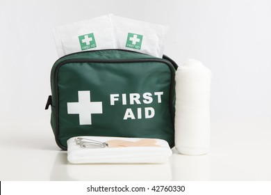 First Aid kit with bandage, plasters,and wipes isolated on a white