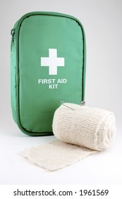 A first aid kit with bandage roll on white