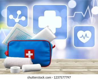 First Aid Kit and bandages  on background