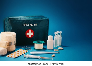 First aid kit content on top of blue background, with available copy space.