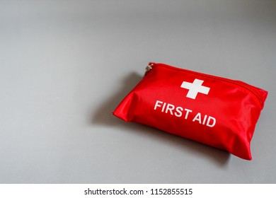 First aid kit on black gray background