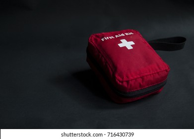 first aid kit on black back
