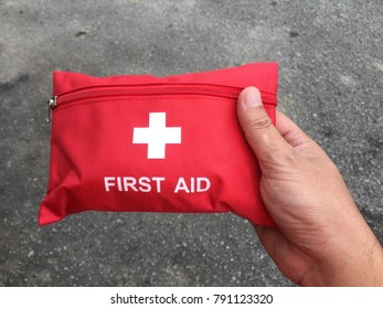 First aid kit in red bag.
