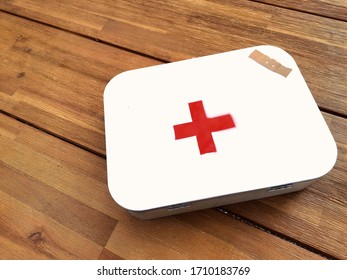 First aid kit in a worden table