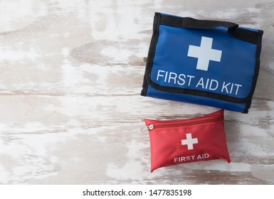 First aid medical kit bag on wood background,copy space,top view