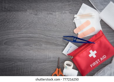 First aid medical kit on wood background,copy space,top view