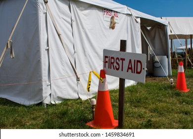 First aid sign in front of tent at campground