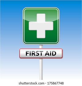 First aid traffic sign with text on blue sky background.