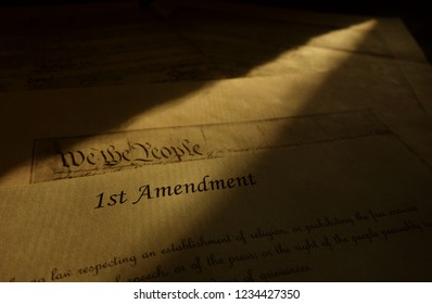 First Amendment parchment and We The People text from the US Constitution