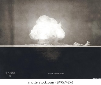 First Atomic Explosion on July 16, 1945. Photograph taken at 9 seconds after the initial Trinity detonation shows the Mushroom cloud. Manhattan Project, World War 2. Alamogordo, New Mexico.