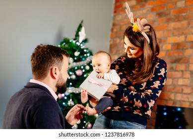 First baby Christmas. Happy family at Christmas
