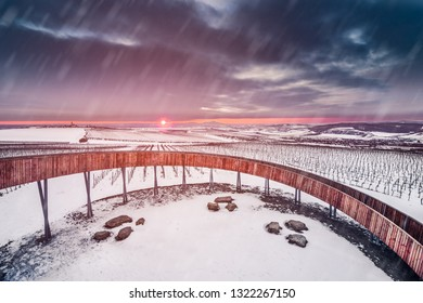 First barrier-free lookout (watchtower) Stezka nad vinohrady (The walk above the vineyards) near Kobylí, South Moravia, Czech Republic during sunset with heavy snowstorm.