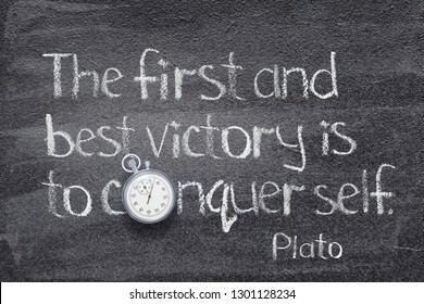 The first and best victory is to conquer self - quote of ancient Greek philosopher Plato written on chalkboard with vintage stopwatch