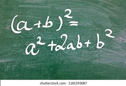 first binomial formula, written with white chalk on a green chalkboard