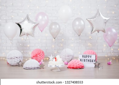 first birthday background - cake, helium balloons and lightbox with happy birthday text