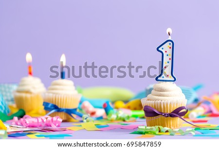 First birthday celebration theme with cupcake candle and party accessories