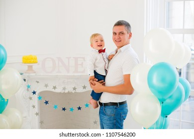 First birthday. Father with son