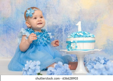 First birthday girl. Portraits with cake