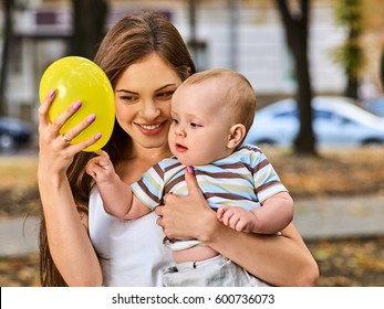 First Birthday Ideas Happy Mother And Her Baby Boy Play With Balloon Outdoors In Summer